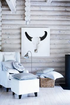 Whitewashing a log house gives it a whole new look.  Whoo boy- the hubs would be horrified if I did this!!!
