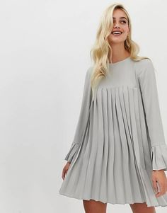 Shop ASOS DESIGN pleated trapeze mini dress with long sleeves in grey. With a variety of delivery, payment and return options available, shopping with ASOS is easy and secure. Shop with ASOS today. Robe Swing, Swing Dress, Dress Skirt, Pleated Dresses, Smock Dress, Dresses Dresses, Dress Brokat Modern, Dress Outfits, Fashion Outfits