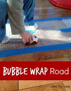 a Bubble Wrap Road Make a Bubble Wrap Road! Easy, fun activity for truck loving toddlers! {Sunny Day Family}Make a Bubble Wrap Road! Easy, fun activity for truck loving toddlers! Transportation Activities, Motor Activities, Timmy Time, Nursery Activities, Activities For 2 Year Olds At Nursery, Toddler Classroom, Toddler Play, Sensory Activities For Toddlers, Sensory Games