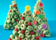 Cheerios® Christmas Trees..  6  cups Honey Nut Cheerios® cereal  6  tablespoons butter or margarine  4 1/2  cups miniature marshmallows   Green food color   Red cinnamon candies or sliced gumdrops
