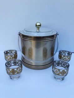 Excited to share this item from my #etsy shop: Vintage , Gold Cocktail Set Includes Signed Georges Briard, Gold Ice Bucket with 4 Small,  22K Gold Overlay, Pedestal Glasses, 5 Piece Set #clear #glass #gold #vintagecocktailset #goldcocktailset #georgesbriard #vintageicebucket #vintagebar #22kgoldglasses
