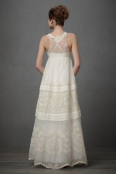 What beautiful construction on the back. I like the sheer fabric on top of the criss cross straps.