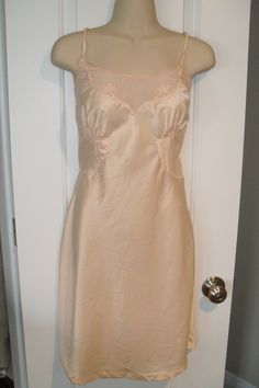Vintage pink slip size 14 miss (womens 8-10) Beautiful silky, peachy pink sheer material by HaberdashAndKitsch on Etsy