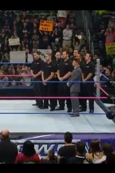 Evan (on the right behind guy in gray suit) on WWE Smackdown 10/26/2012