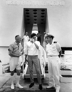 Elvis Presley wipes away a tear after visiting the Arizona Memorial. Presley's March 1961 Bloch Arena concert raised some $50,000 toward construction of the memorial, which was dedicated the following year.