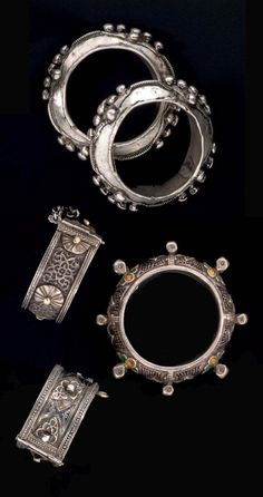 Morocco | 1) Pair of silver bracelets from the Bani Oasis, Guelmim region. 2) Silver and enamel bracelet from the Tafraout region and 3) Two old silver hinge bracelets from the Central Anti Atlas region | Est. 1'200 - 1'500€ ~ (June '14)