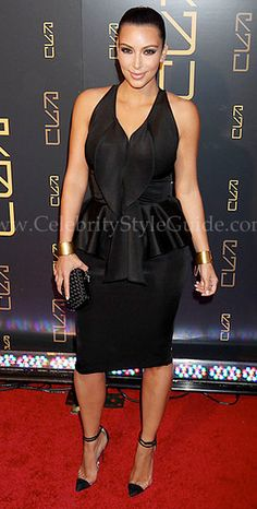 Kim Kardashian stuns in a black Givenchy Peplum Dress at the opening of Scott Disick's RYU Restaurant in New York City