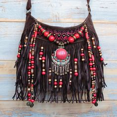This purse is: - Made with vegan suede leather - Lined interior with zip and a back pocket - Adjustable shoulder strap, can be worn across the body or on the shoulder MEASUREMENTS - Length 28 cm / 11 in - Width 10 cm / 4 in - Depth 19 cm / in Boho Hippie, Hippie Bags, Boho Bags, Hippie Style, Boho Style, Fringe Handbags, Fringe Purse, Fringe Bags, Purses And Handbags