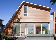 This cedar-clad Vancouver house features a lopsided roof that follows the line of the staircase.