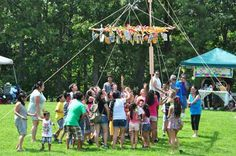 Children race to snatch up a prize during pabitin, a traditional Filipino game akin to a piñata.
