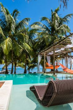 A beachfront infinity pool is decked out with overwater hammocks and cabana beds. #Jetsetter