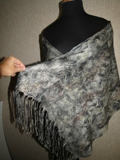 Stylish, one of a kind black and white scarf for autumn and winter. Great warm seasonal gift for you or your closest one. Made in a wet felting technique using Australian fine merino wool and decorated with viscose fibers. Length:180 cm (70.8) Width:70 cm (27.5) If you need a different color or size, write me, together we will find the best solution and I will make specially for you! All the designs are one of the kind and completely handmade, using only wool, hot water and soap. The felt…