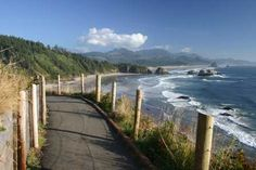 """One of our favorite places to go as a family is to visit my brother-in-law and his family, who live in Cannon Beach, Oregon...  Haystack Rock there in the distance.  Fun little beach town... not the """"layout and tan"""" beach, but still..."""