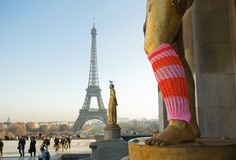 Statue dressed for visiting the eiffle tower by Magda Sayeg - Knitta, Please
