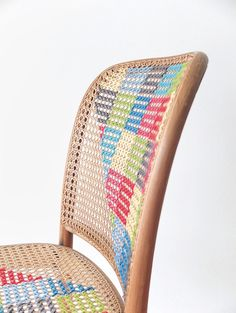 Cross-Stitch Chair by Cintia Gonzalez. Cintia describes her work as creating something useful and beautiful out of things that were previously unloved. The Cross-Stitch Chair is a perfect illustration of this distinction, using minimal materials to give new life to a handwoven cane seat that was found abandoned by the roadside.