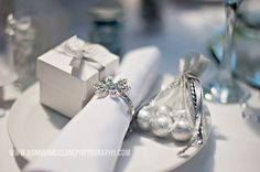 Winter Wonderland wedding table styled by www.fuschiadesigns.co.uk for Asian Bride Live Wedding Exhibition.  These stunning favours are gorgeous for family and friends to take home after the wedding or enjoy the chocolates at the table.  From ribboned boxes complete with heart milk chocolates inside, or diamonte voile bags with milk chocolates balls in foil wrappers.
