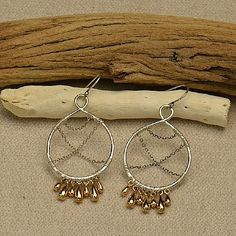 Elegant, cascading earrings, perfect for day-to-night wear. The solid bronze teardrop charms give this pair a luxurious feel, and the mix of silver and bronze give a warm contrast. http://www.ninadesigns.com/jewelry_design_ideas/teardrops_and_chain.html
