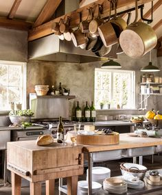 This homeowner opted to build a spacious, chef-worthy cookhouse in an outbuilding 30 feet from the cabin. The cookhouse's simple concrete walls link the modern appliances and the rustic surroundings.