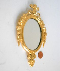 Beautiful Vintage Italian Small Wall Oval Mirror,in Distressed Gold leaf,to outstand  its ornate detailing in inner frame.  Ready to Hang! Already