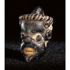 A Phoenician or Carthaginian Core-Formed Glass Pendant in the Form of the Head of an African by Ancient Art, via Flickr