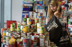 Emergency relief food bank being stocked after kilo of kindness Easter weekend. Easter Weekend, Food Bank