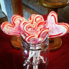 I love it when a Pinterest project works! Preheat your oven to 350°, use parchment paper or lightly spray a cookie sheet. Place candy canes on cookie sheet on each side of a lollipop stick to form a heart. Bake for 3 to 5 minutes, just until candy is pliable. Carefully pinch end of candy canes together onto lollipop stick. Let harden. Microwave white chocolate in a bowl and spoon into the middle of candy canes. Shake colored sprinkles onto middle of lollipops. Set cookie sheet in fridge…