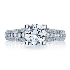 Tacori - Engagement ring with a round cubic zirconia center stone and 86 diamonds with .70ctw set in 18KT white gold.