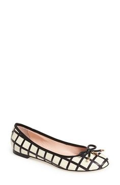 kate spade new york A prim, charm-embellished bow lends unmistakable signature sophistication to a lithe skimmer flat.