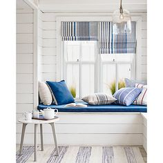 Buys to Embrace the Coastal Interiors Trend A bright and airy window seat in a beach house living room. Nautical never looked so good.A bright and airy window seat in a beach house living room. Nautical never looked so good. Coastal Bedrooms, Coastal Living Rooms, Home Living Room, Trendy Bedroom, Beach Cottage Bedrooms, Coastal Curtains, Coastal Bedding, Curtains Living, Style At Home