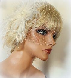Check out this item in my Etsy shop https://www.etsy.com/listing/290003549/ivory-wedding-hair-fascinator-and-french