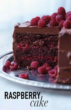 Chocolate-Raspberry Cake | Martha Stewart Living - This beauty is baked with a splash of Chambord and layered with a sweet raspberry filling, both of which offer bright counterpoints to the thick layer of chocolate-cream cheese frosting and whole berries scattered on top.