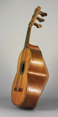 Guitarrón mexicano : : a very large, deep-bodied Mexican six-string acoustic bass [played traditionally in Mariachi groups].