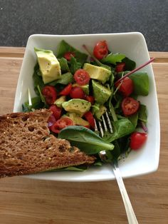 Simple food is the best food. Spinach, greens, and arugula salad with avocado, lime, tomatoes, olive oil, white balsamic vinegar, salt, pepper, and a side of multigrain toast!
