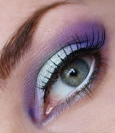 Purple eye make up, with a touch of a silvery greenish color, with green/blue eyes
