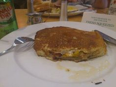 The Caker @ Hazel's Diner on Mt. Pleasant in Toronto. Layers of egg, cheese & bacon surrounded by pancake!