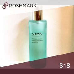 Ahava Dry Oil Body Mist Sea-Kissed 3.4 oz about 3/4 full. An AHAVA fan favorite in a fresh new scent! A tranquil, fragrant blend of light and nourishing oils dries instantly to recharge skin with natural moisture. This Sea-Kissed scented spray-on dry oil instantly envelops skin with a hydrating mist that leaves it feeling soft and glowing, transporting your senses to paradise. Experience instant hydration plus cool water freshness and sun-kissed skin with hints of salty sea air. Ahava Other