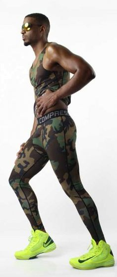 Camouflage Sportswear Set. Command all eyes on you in a bold military print. Lightweight material is a spandex/polyester blend scientifically engineered to wick sweat. This soft fabric effortlessly stretches with movement for maximum comfort. Choose this sportswear set to make an athletic fashion statement with army flair. | www.differio.com Stylish Mens Fashion, Sport Fashion, Funky Outfits, Sport Outfits, Athletic Fashion, Athletic Wear, Mens Activewear, All About Eyes, Tights