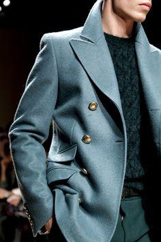 Light blue/grey coat.