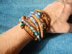 Wrap Bracelet// Rustic Wrap Bracelet// Leather Wrap Bangle// Unique Boho Bracelet// Boho Chic Kauai,Triple wrap bracelet....One of a Kind Natural (will get darker with time) Napa leather braided, multi cord bracelet. A unique combination of High-fired stoneware,,fresh water pearl and semi-precious stone beads combine to make this 3x wrap bracelet. It is adorned with a magnetic clasp that makes it very easy to put on by yourself. Kauai Triple Wrap Bracel...