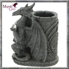 DRAGON CRYSTAL GOTHIC TOWER PEN POT PEN HOLDER STORAGE POT. This Gothic Dragon sits in front of a Gothic Castle's Tower with a crystal in its talons. Its wings wrapped around the Celtic engrave fortress. Ideal for pens, bits and bobs or even Potpourri if you still have a leg in the 1980s.