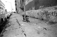 girls alone - Vladimir 'Boogie' Milivojevich. (All photos were taken between  2003-2006 in BedStuy, Bushwick which are considered to be some of the roughest neighborhoods in NYC). I can only imagine the responsibility the young girl is taking, having to look after her younger sibling while her parents are off doing god knows what.