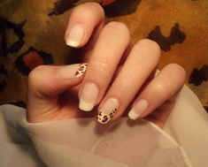 French tips on French manicure, the French manicure is maybe the hardest part and then the tips with a leopard print.This Leopard print on French manicure looks absolute awesome.