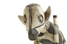 Head of black and white striped dog carving from Nigeria which dates from 1900 - 1917. Charles Partridge Collection, World Collection, Ipswich.