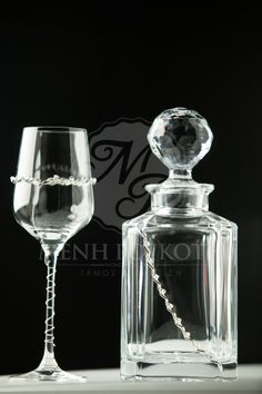 Wine glass and wine decanter with silver decoration