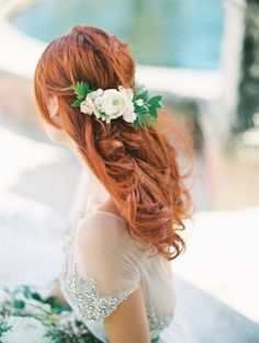Romantic half-up wedding hairstyle with flowers insert