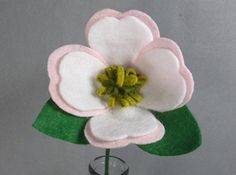 Pink and White Dogwood Flower Made of Felt - Artificial Flower on a Stem - Felt Flower - Fake Flower - Artificial Flower - North Carolina State Flower. This is a beautiful flower made of felt that lasts forever! It looks great in a vase by itself or as part of a bouquet. The stem is made of a floral wire, so it is stable but bendable. Price is for ONE flower. If you want another color, please check my shop. If you don't see the color you want there, please message me. I have many…