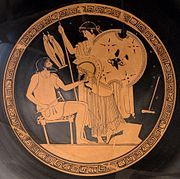 Hephaestus   Crippled god of fire, metalworking, and crafts. The son of Hera by parthenogenesis, he is the smith of the gods and the husband of the adulterous Aphrodite. He was usually depicted as a bearded man with hammer, tongs and anvil—the tools of a smith—and sometimes riding a donkey.