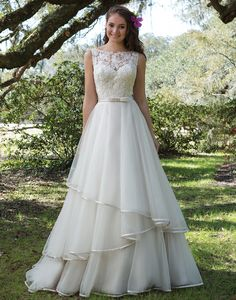 COMING SOON! Sweetheart Gowns sweetheart style 6175 Sand/Ivory Size 14 This ball gown is the perfect combination of charming details and modern styling with its Sabrina neckline, sequined appliques, keyhole back, satin belt at the natural waist, and tiered ribbon edged skirt.