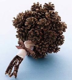 Alternative Wedding Bouquet - Glittered Pinecones! With a deep orange or red ribbon this could be beautiful...