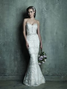 Allure Couture C288. This dress is breathtaking! The pattern of the details on this dress are so unique.